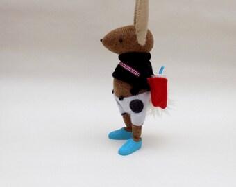 Woollen Bunny  -  Handmade woolly plush rabbit wearing black woollen pullover and black spotty felt skirt.