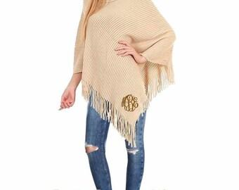 Monogram Poncho - Beige knit cowl neck poncho with monogram and fringe