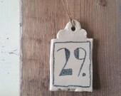 random number tile (29.)