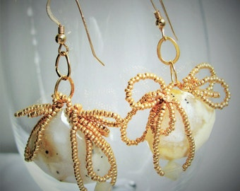 Sophisticated whimsy.  Original, one-of-a-kind, hand made, beaded drop earrings.