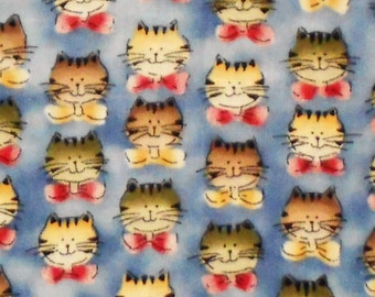 All over kitty faces on coton fabric with blue background one yard