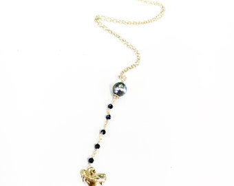Shark tooth necklace in gold featuring pearls & black spinel rosary
