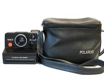 Polaroid 1000S Land Cámera - green button [includes original box and original book instruccions]