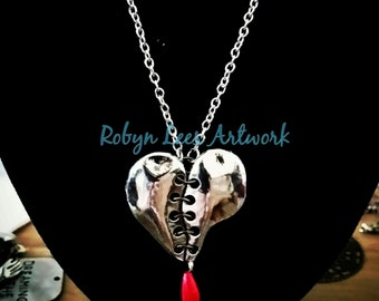"""To Mend A Broken Heart Necklace with Silver Heart """"Sewn"""" Together with Black Links and Pearl Blood Drop"""