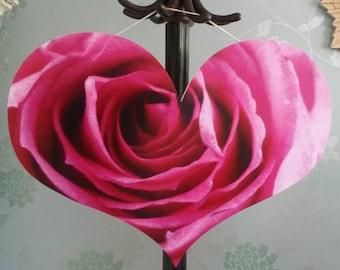 Large pink heart in rose design.