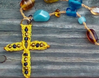 beaded macrame cross necklace in blues and yellows