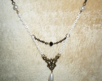 "necklace ""whack and blite"""