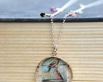 Vintage birds collage set under resin in sterling silver pendant on sterling necklace with flourite beads. Bird jewelry