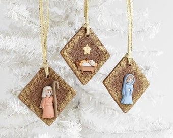 Nativity Scene Christmas Ornaments with Gold Glitter Ribbon. Handmade Joseph, Mary, Baby Jesus Square Clay Christmas Holiday Gift Set of 3