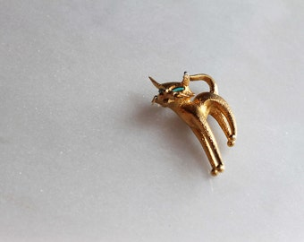 50s cat brooch with turquoise eyes