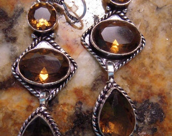 PRE-HOLIDAY SALE....Gently Dissolve Negative Energies By Wearing...The Smokey Quartz From Brazil...Set In 925 Sterling Silver