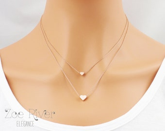 Choose rose gold, silver or gold. Two dainty mother daughter heart necklaces.