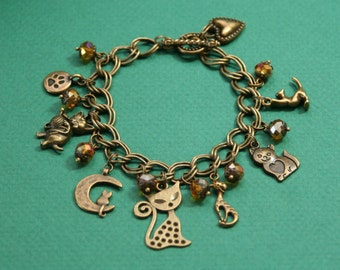 Kitty Charm Bracelet in Antique Brass- 7 charms