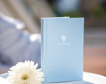 """Travel Planner """"Be Adventurous"""" Baby Blue Fabric Hard Cover Journal with White Foil Stamp"""