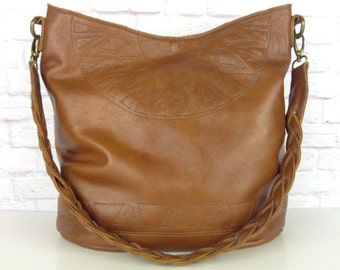 Tobacco leather hobo bag with braided strap and geometric decorative stitching