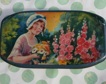 Art Deco tin with young girl and flowers