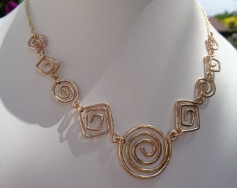 Unique! Designer necklace in gold 585 with spirals in the hammer blow design