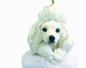 """White Poodle Christmas ornament, handpainted and handcrafted. Measures 4"""" tall x 2"""" wide."""
