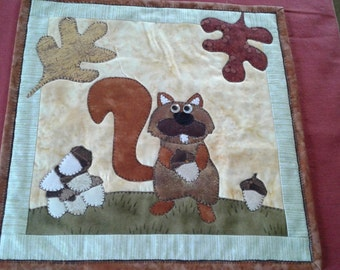 Squirrel and acorns wall hanging