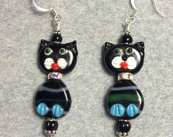 Black and light blue lampwork cat bead earrings adorned with a rhinestone collar and black Czech glass beads.