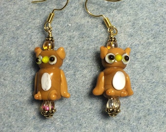 Tan and white lampwork owl bead dangle earrings adorned with tan Czech glass beads.