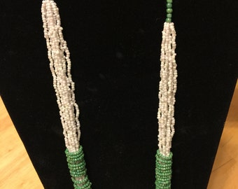 Ivory wrapped emerald necklace