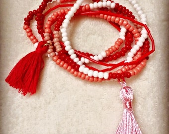 Lot of 6 bracelets, multi-colored beads with PomPoms red and pink