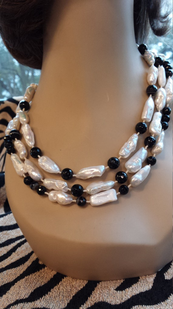 Three strand freshwater pearl and faceted black onyx necklace