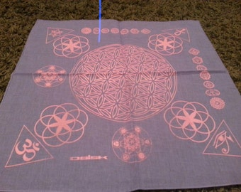 Violet bandana with sacred geometry done in florescent pink