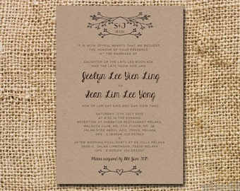 Rustic wedding invitation with hand drawn twigs and a sweet cursive font.