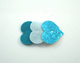 Shades of Blue. Glitter Heart Clips. Toddler Hair Clips. Glitter Snap Clips. Toddler Barrettes. Little Girl Clips. Heart Snap Clips.