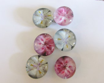 Glass marble magnets with pink and white flowers