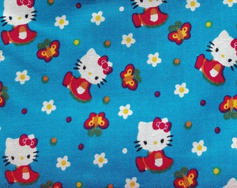 """100% Cotton Fabric Hello Kitty and Butterflies on Sky Blue Background Fat Quarter 18"""" x 22"""""""