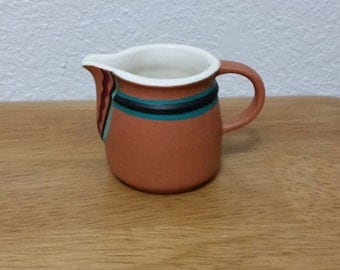 Ceramic Pitcher (#126C) - Clear Glazed on the inside and stained Terra-cota on the outside