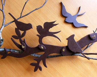 Wooden birds key holder on the branch. Key wall hook