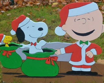 Charlie Brown, Snoopy and Woodstock doing there magic lawn Christmas decorations and lawn stake