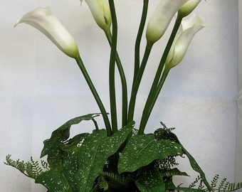 Stunningly realistic artificial calla lilies and leaves arranged in a top quality black metal planter