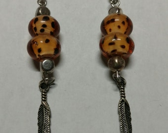 Leopard print bead with feather earring