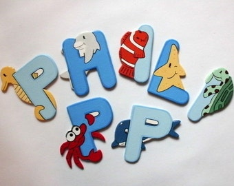 Wooden alphabet letters with marine life