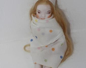 little porcelain art doll