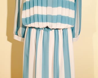 Nowhere to be found. Striped dress super special! With pleats and belt.