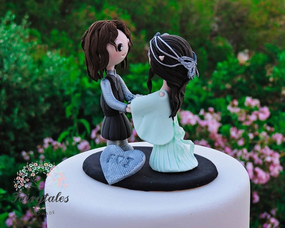 dirty wedding cake toppers lord of the rings wedding cake topper 13537