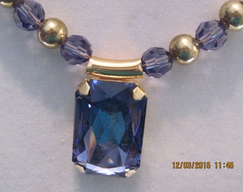 19 inch swarovski tanzanite pendant with gold setting and tanzanite beads interspersed with gold beads