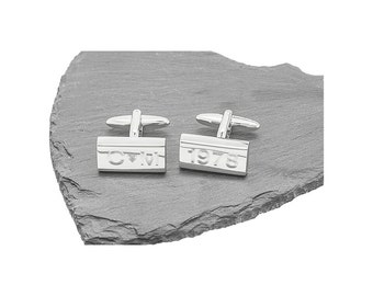 Personalised brushed rectangular cufflinks with shiny edges presented in chrome box