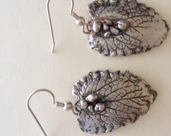 Sterling silver mint leaf dangle earrings.