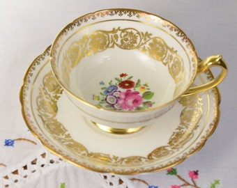 Paragon hand painted white cup and saucer