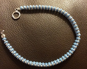 Light blue and gray single bead bracelet