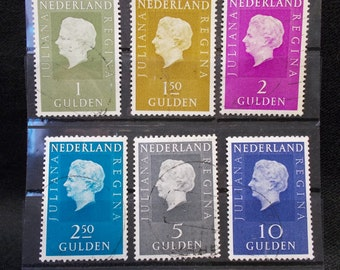Set of six used vintage postage stamps of queen Juliana from the Netherlands.
