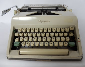 NOW SOLD A Vintage Olympia Typewriter, in case, good condition.Desk addition, collectable, stationary