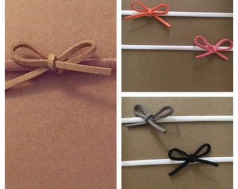 Suede bow on a nylon headband